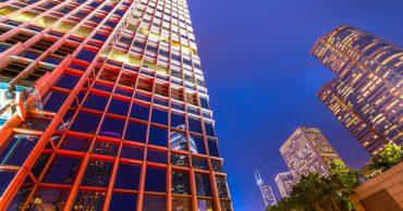 low angle office buildings at night hong kong
