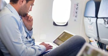 travel for work reduce stress flying working laptop